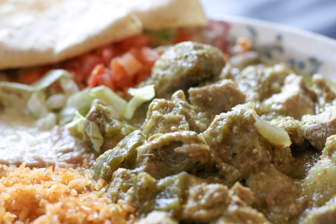 Chile Verde: Pork loin braised in a green tomatillo sauce, green peppers, onion and spices.